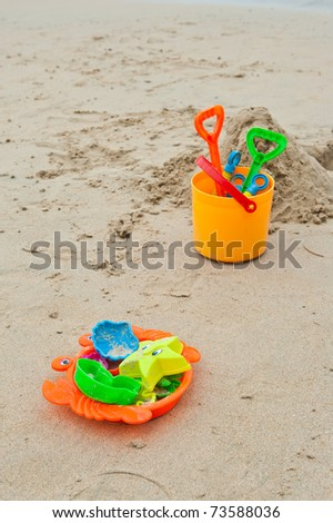 colorful plastic toys on the beach - stock photo