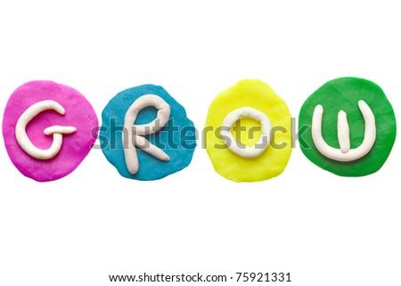 Colorful plasticine alphabet form word GROW - stock photo