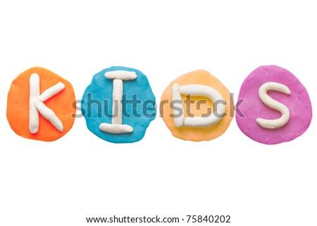 Colorful plasticine alphabet form word KIDS - stock photo