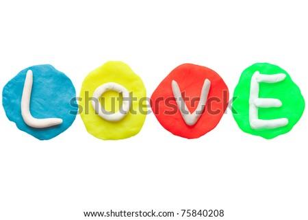Colorful plasticine alphabet form word LOVE - stock photo