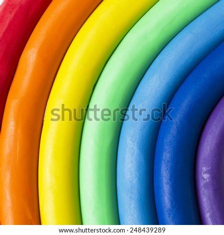 Colorful plasticine rainbow - stock photo