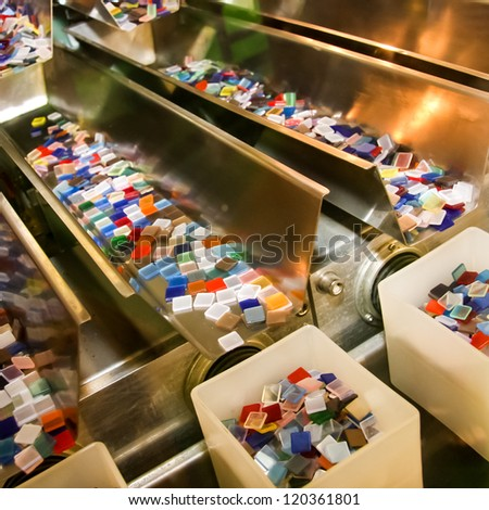 Colorful plastics boxes in the line of industry - stock photo