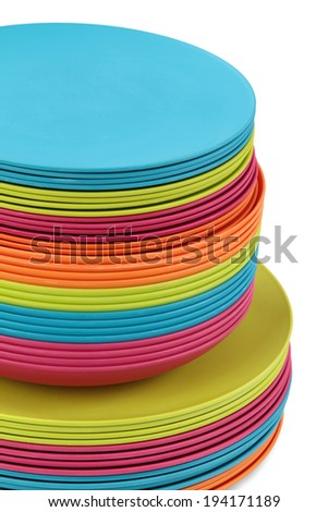 Colorful plates stacked isolated on white background  - stock photo