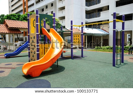 Colorful playground for childrens in public housing block.
