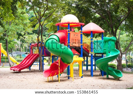 Colorful playground fun red day ice set joy kid cold baby park blue play game slide green place color climb empty child happy nobody season ladder nature ground outdoor - stock photo