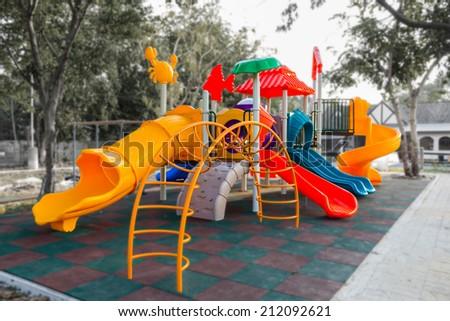 Colorful playground in villa park  - stock photo
