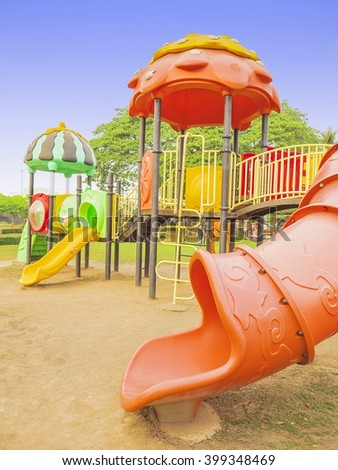 Colorful playground with blue sky background - stock photo