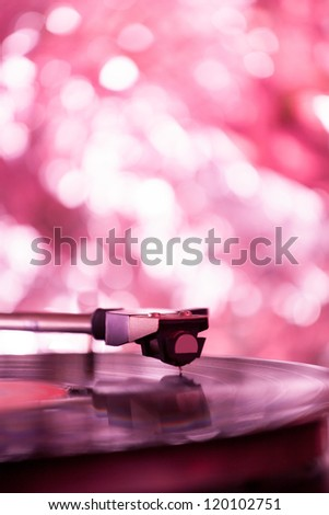 Colorful playing vintage gramophone with blurred blackground - stock photo