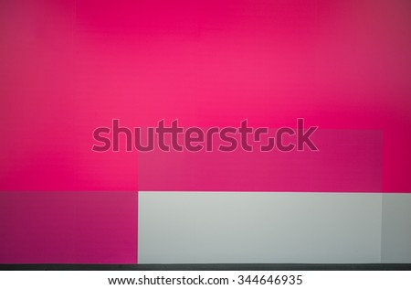 Colorful Plywood Wall.  Colorful construction wall painted in bright colors for use as an advertising backdrop/message. - stock photo