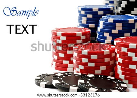 Colorful poker chips on white background with copy space.  Macro with shallow dof. - stock photo