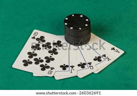 Colorful poker chips with cards on black background - stock photo