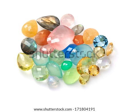 Colorful polished gemstones. Many different colors and shapes isolated on the white background. - stock photo