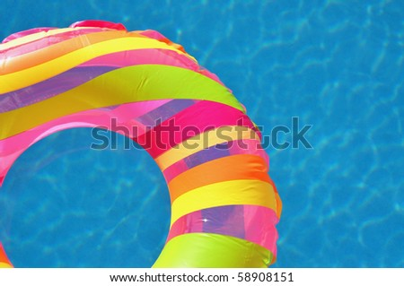 Colorful pool float - stock photo