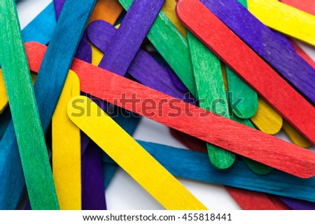Colorful popsicle sticks over white background (Shallow depth of field)