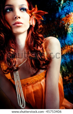 colorful portrait of a summer girl with flower in hair - stock photo