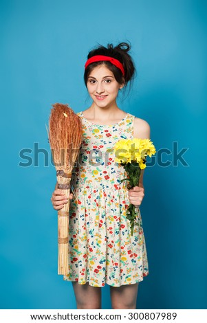 colorful portrait of young sexy funny fashion girl posing on blue wall  - stock photo