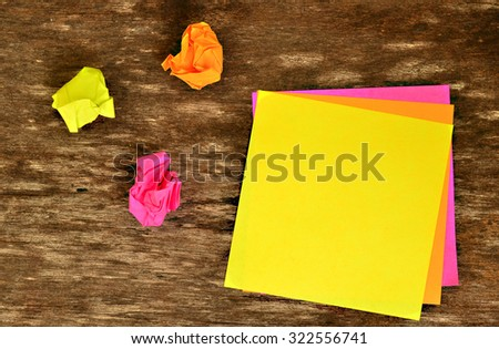 Colorful post note and used post note on wood board. Colorful post note have three color as yellow post note, pink post note , orange post note . Post note is object. People write in post note  - stock photo