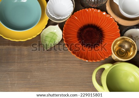 Colorful pottery on a wooden background - stock photo