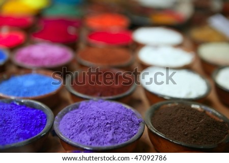 colorful powder pigments in rows in clay bowls - stock photo
