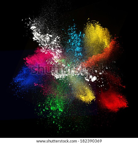 Colorful powders,  on black background - stock photo
