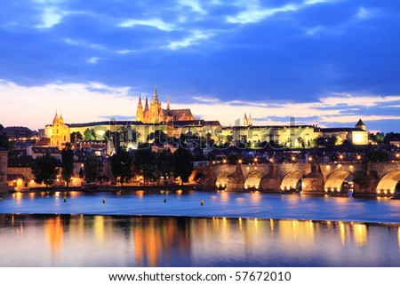 Colorful Prague gothic Castle above the River Vltava with Charles Bridge after Sunset - stock photo
