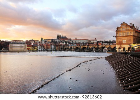 Colorful Prague gothic Castle above the River Vltava with Charles Bridge after Sunset, Czech Republic - stock photo