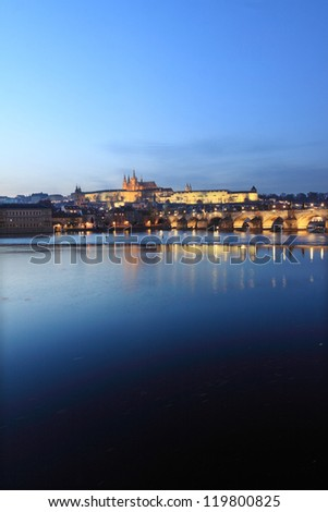 Colorful Prague gothic Castle above the River Vltava with Charles Bridge in the Night, Czech Republic