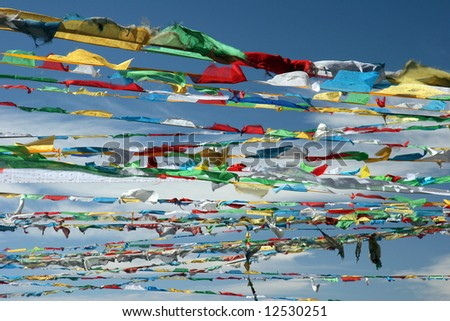 Colorful prayer flags against blue sky. High mountain pass over 5.000 m. Tibet - stock photo