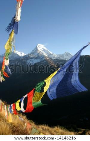 colorful prayer flags in himalaya region, nepal - stock photo