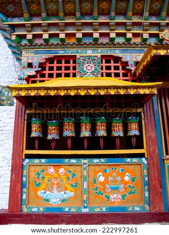 Colorful prayer wheels in Sikkim, India for good karma - stock photo