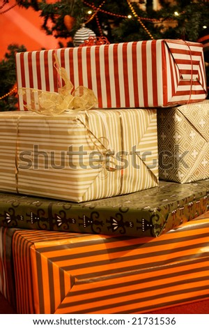 colorful present boxes under christmas tree - stock photo