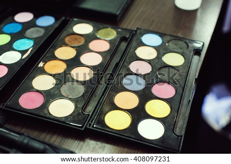 Colorful professional eyeshadow palette for makeup artists and personal use - stock photo