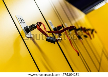 Colorful public lockers with keys. Security concept. - stock photo