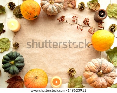 Colorful pumpkins with candles.on white wood background.Image of Halloween season
