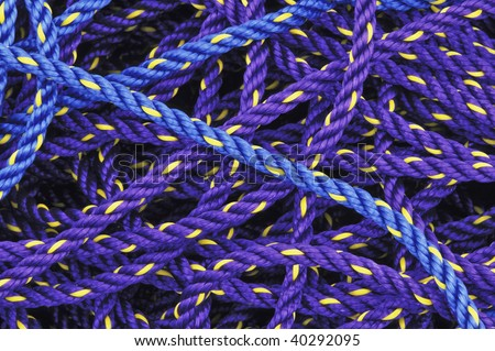 Colorful purple and blues fishing ropes - stock photo