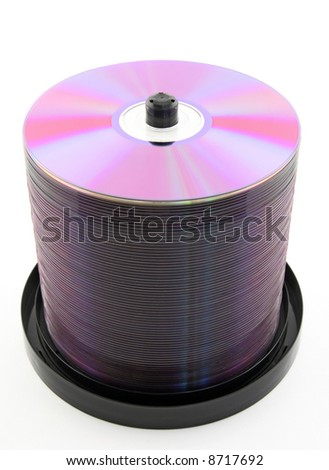 Colorful purple DVDs or CDs on spindle, on white background. No dust. - stock photo