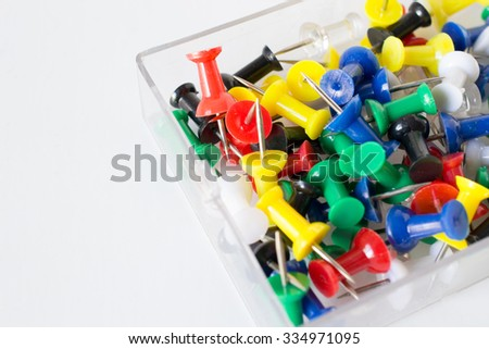 colorful pushpin texture inside glass box, push pins on the white background