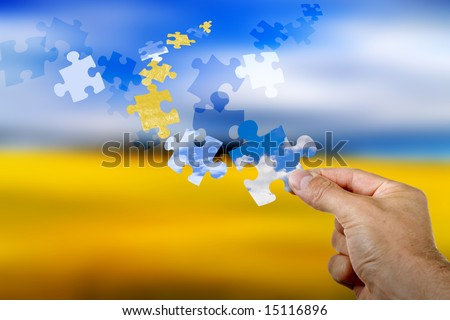 Colorful puzzle pieces flying through the sky - stock photo