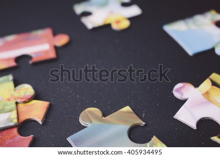 Colorful puzzle pieces on the black background - stock photo