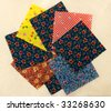 COLORFUL QUILTING SQUARES ON BATTING MATERIAL - stock photo