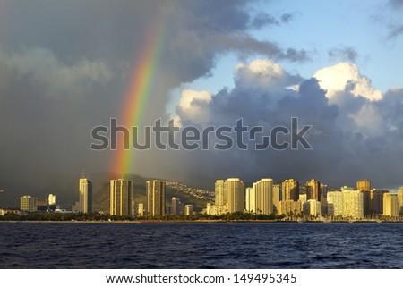Colorful rainbow over Oahu, Hawaii skyline - stock photo
