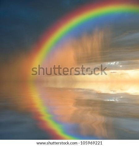Colorful rainbow over water, thunderstorm with rain on background - stock photo