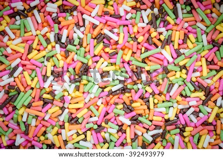 colorful rainbow sweet candies spreading pastry decoration background - stock photo