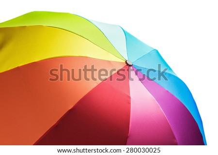 Colorful rainbow umbrella isolated on white background - stock photo