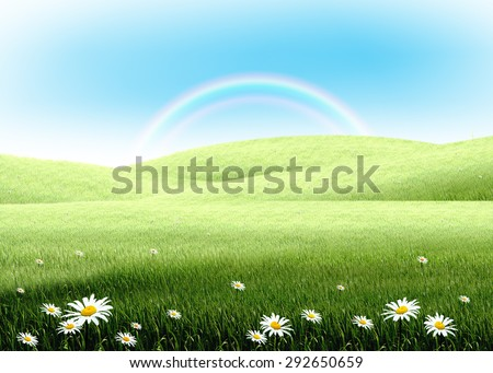colorful rainbow with white flowers and green grass lawn field over plain blue sky. Hope, happy, nature, natural idea template background - stock photo