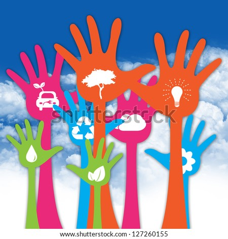 Colorful Raised Hands With White Icon Inside For Think Green Or Sustainable Development & Environment Concept in Blue Sky Background - stock photo