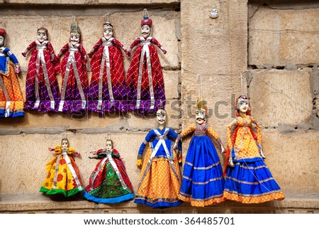 Colorful Rajasthan puppets hanging in the shop of Jaisalmer City Palace, India    - stock photo