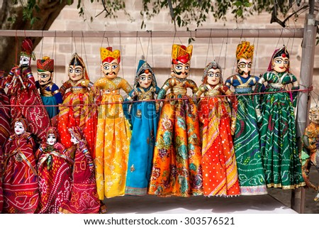 Colorful Rajasthan puppets hanging in the shop of Jodhpur City Palace, India    - stock photo