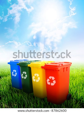 Colorful recycle bins ecology concept with landscape background. - stock photo
