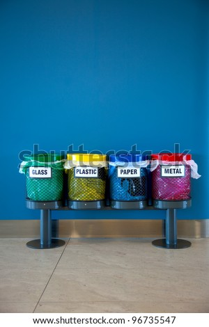Colorful Recycle Bins in a Public place / vertical - stock photo